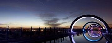 The Falkirk Wheel lit up at night