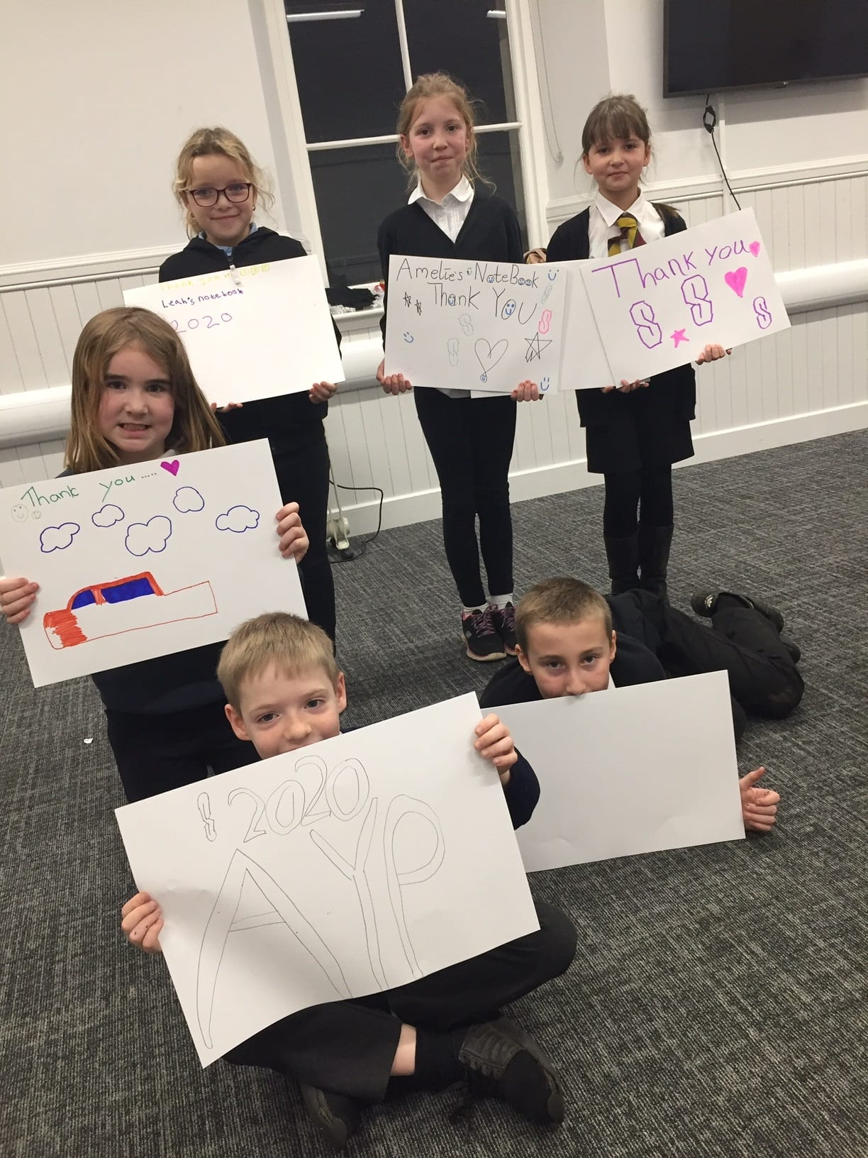 Children from Alyth Youth Partnership hold up pictures they have made